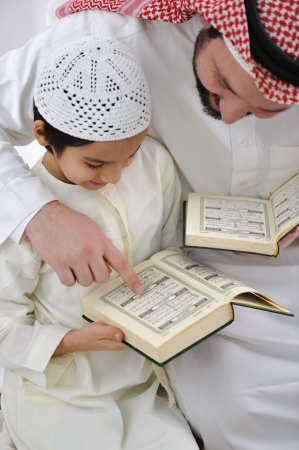 Arabic Kid and teacher reading together photo
