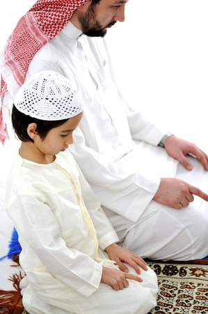 Father and son praying together photo