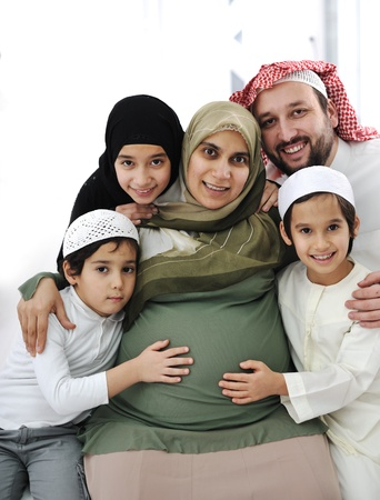 Arabic Muslim family, pregnant woman with mand and little girl and boys 스톡 콘텐츠