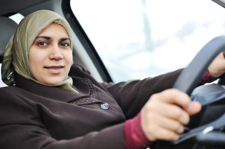 woman driving car: muslim woman in a car