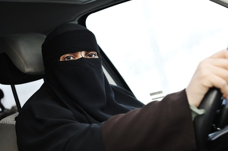 Leasing: Arabic Muslim woman with veil and scarf (hijab and niqab) driving car