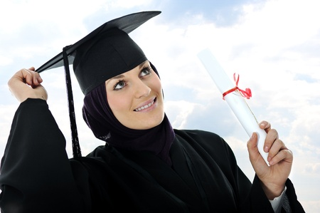 girl in a hat: Happy graduate muslim student with diploma