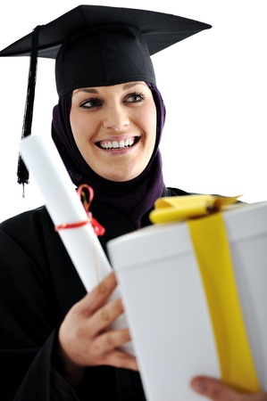 Young arabic muslim female graduating and receiving diploma and gift photo