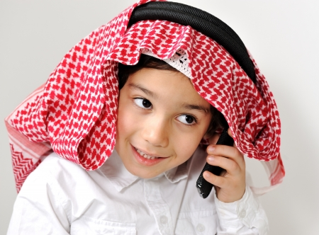 Middle Eastern Arabic Little Boy Speaking on Phone photo