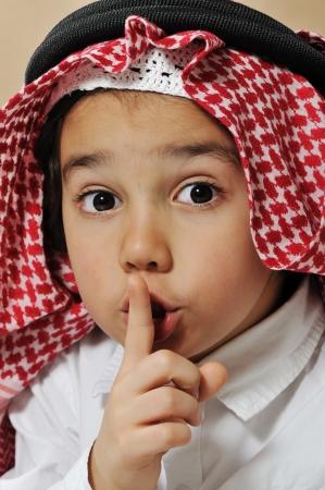 Cute arabian kid asking for silence, secret photo