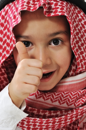 Cute kid with thumb up photo