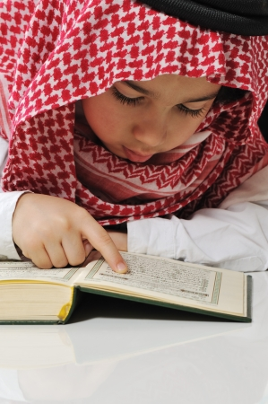 middle eastern clothes: Muslim boy reading Koran
