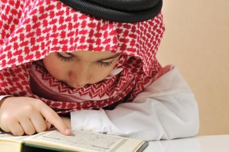 Muslim boy reading Koran