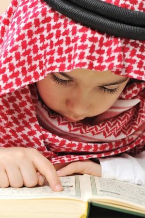 koran: Muslim child with Koran