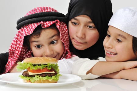 middle eastern families: Arabic family children with hamburger