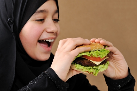 Arabic girl eating burger