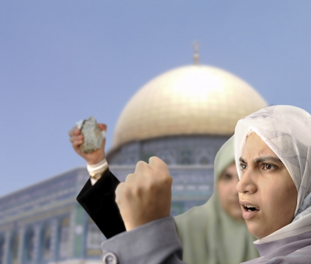 women fighting: Angry Palestine women fighting with rocks in hands