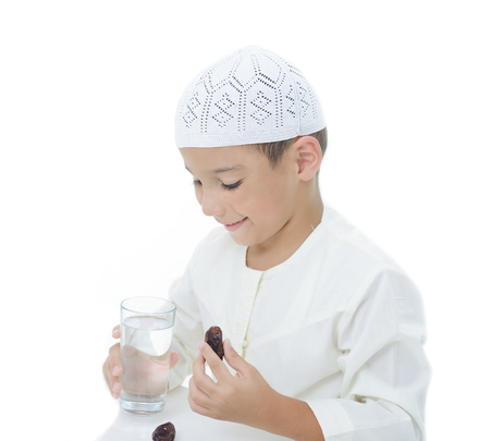 A little muslim boy wearing islamic attire ready for braking Ramadan fast Reklamní fotografie