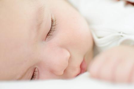 Baby newborn sleeping on blanket