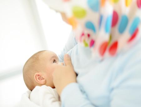 Muslim mother is breast-feeding her baby