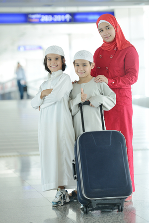 Young Arabic passengers traveling at the airport