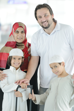 Young Arabic passengers traveling at the airport photo