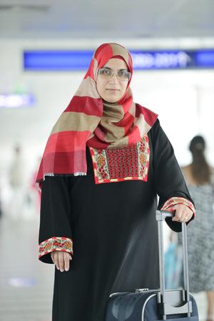 arab hijab: Young Arabic passengers traveling at the airport