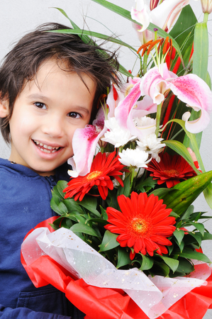 Happy boy with a bouquet of roses photo