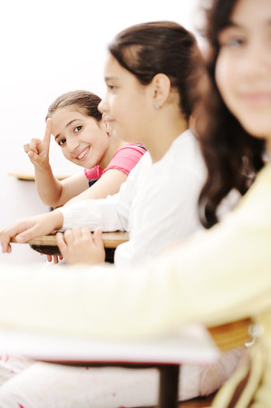 learning arabic: Happy children smiling and laughing in the classroom Stock Photo