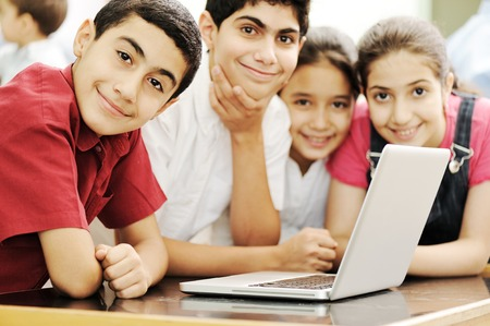 Happy children smiling and laughing in the classroom Standard-Bild