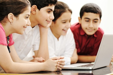 girl friends: Happy children smiling and laughing in the classroom Stock Photo