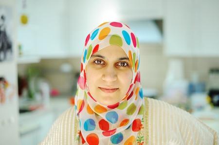 arabian food: Beautiful muslim woman standing in kitchen