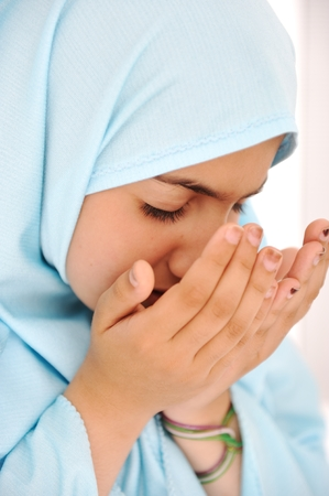 muslim prayer: Closeup portrait of pretty little Arabic girl Stock Photo
