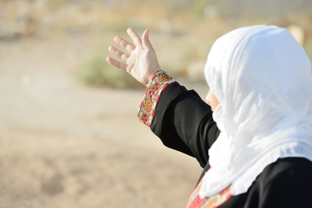 Desperate Arabic woman on Middle East photo