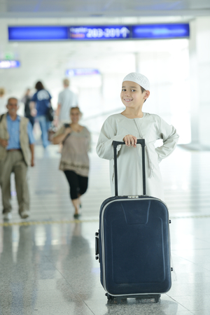 Young Arabic kids passengers traveling at the airport photo
