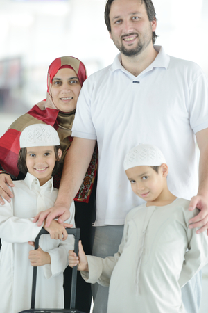 middle eastern families: Young Arabic passengers traveling at the airport