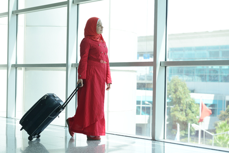 arrive: Young Arabic passengers traveling at the airport