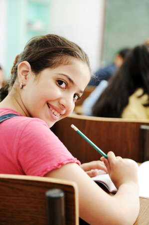 working class: Happy children smiling and laughing in the classroom Stock Photo