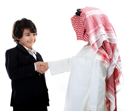 Middle eastern and european children businessmen making a business deal photo
