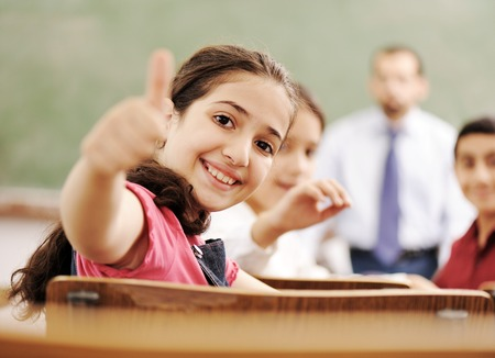 Happy children smiling and laughing in the classroom 스톡 콘텐츠