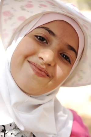 muslim baby: Smiling little girl, Outdoor portrait Stock Photo