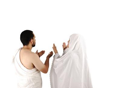 muslim pilgrim in white traditional clothes
