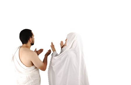 coran: muslim pilgrim in white traditional clothes