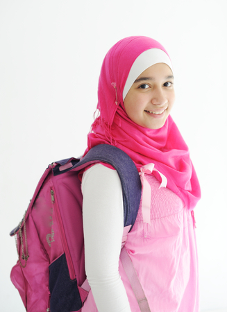 innocent girl: Middle eastern Arabic girl wearing pink hijab scarf on white