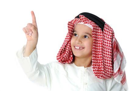 arab teen: Cute Arabic little boy pushing digital button