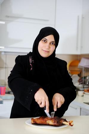arabic woman: Beautiful muslim woman in the kitchen