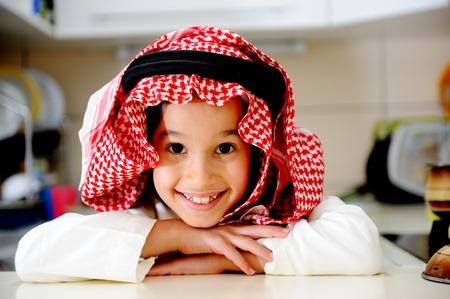 arabic food: Little kid boy is cooking