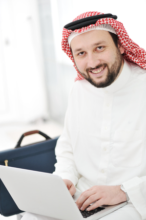 Modern arabic businessman with laptop Reklamní fotografie