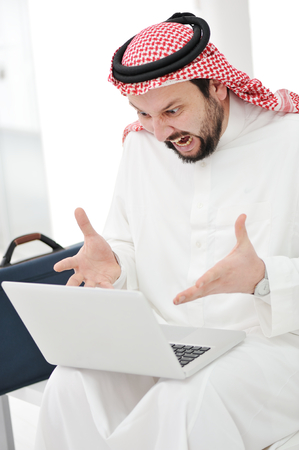 Modern arabic businessman with laptop photo