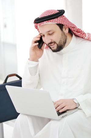 Modern arabic businessman with laptop photo