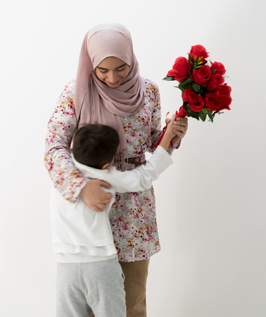 Muslim girl with roses 스톡 콘텐츠