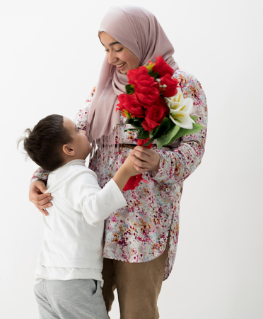 Muslim girl with roses Reklamní fotografie