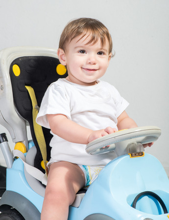 A Cute Baby Riding on a car Toy