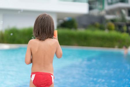 Kid on pool