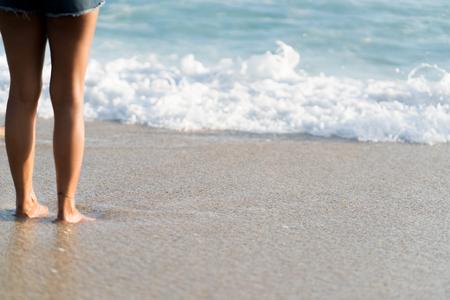 Girl legs on beach